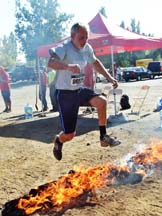 Runner leaping over fire. Photo by Alheli Curry.