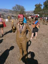 Angela Young covered in mud. Photo by Alheli Curry.