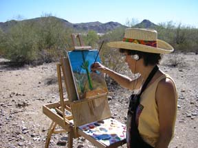 Artist Angie Young painting in the Arizona desert